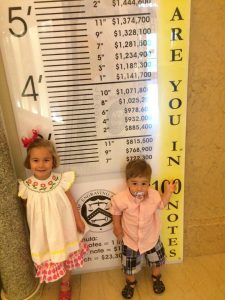 Kids measuring themselves